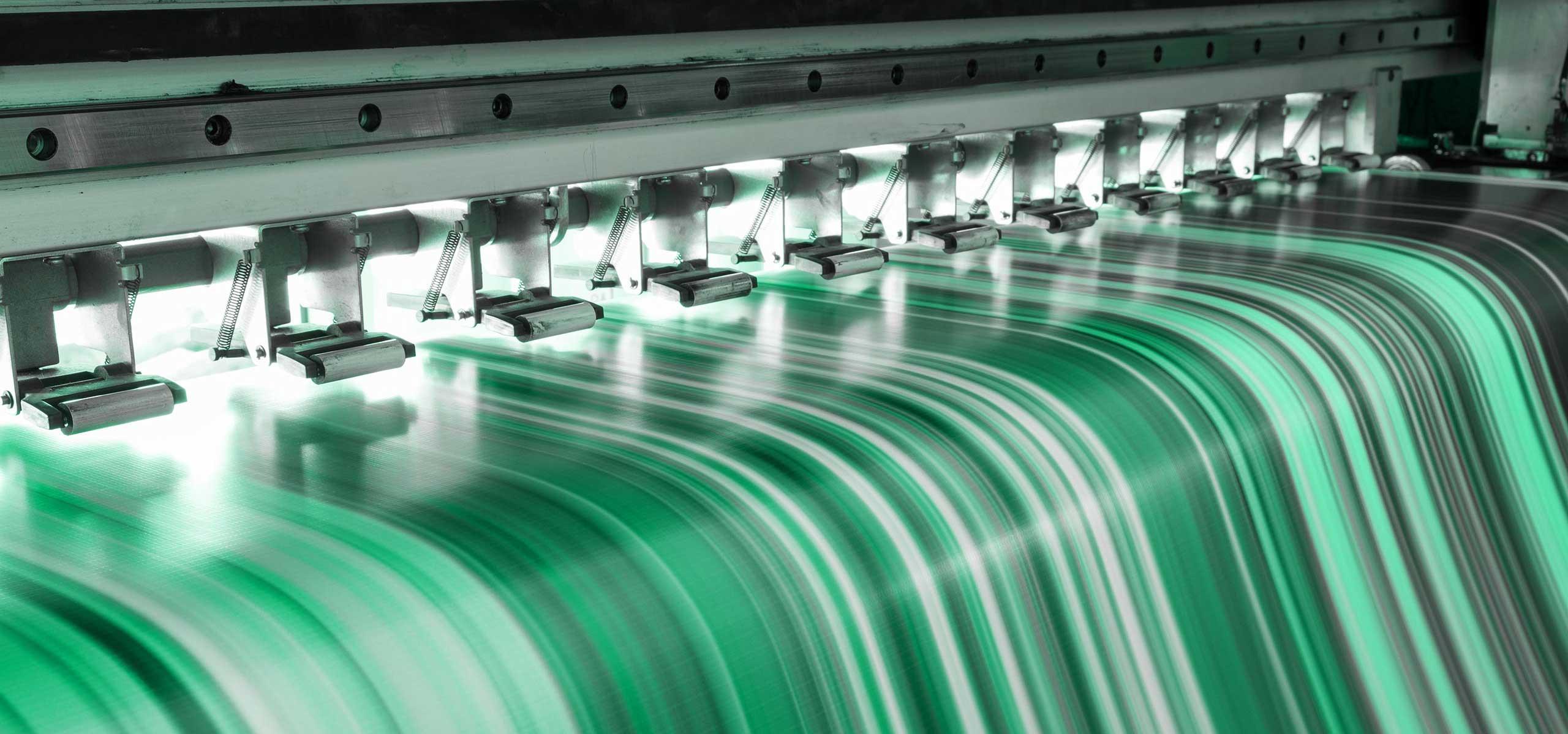 Large format printer printing in full color.